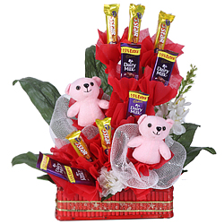 Delicious Selection of Cadbury Chocolates with Twin Pink Teddy together in a Basket