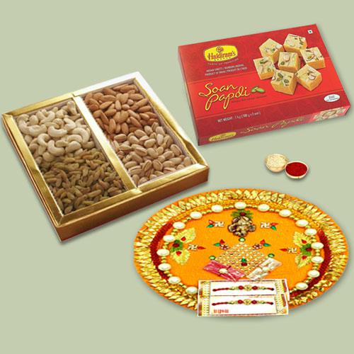 Impressive Display of Decorative Thali with Soan Papdi, Mixed Dry Fruits N Fancy Rakhi for Brother