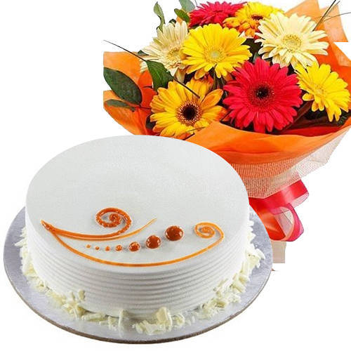 Yummy Combo of Vanilla Cake with Mixed Flowers Hand Bunch