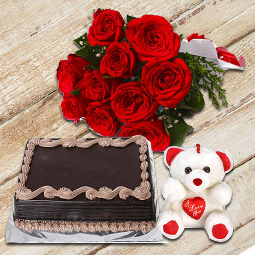 Delectable Chocolate Cake with Small Teddy N a Hand Bunch of Red Color Roses
