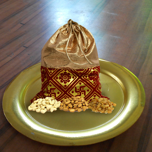 Blissful Dry Fruits Potli with Decorative Golden Plated Thali