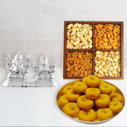 Arresting Silver Plated Ganesh Lakshmi with Dry Fruits and Sweets Gift Set