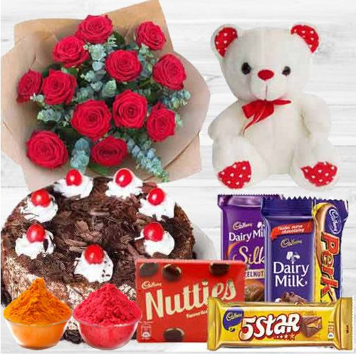 Graceful bouquet of  12 Dutch Red Roses with Cake, assorted Cadburys Chocolate and small Teddy Bear