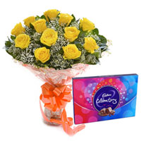 Artistic Bouquet of Yellow Rose and Cadbury Celebration