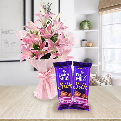 Impressive Combo of Pink Lilies Bouquet and Dairy Milk Silk