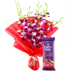 Anniversary Perfect Combo of Dairy Milk Silk and Orchids Bouquet