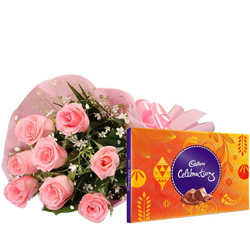 Lovable Anniversary Combo of Pink Roses and Cadbury Celebration