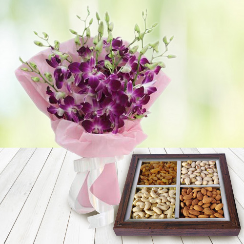 Anniversary Overflowing Combo of Dry Fruits and Orchids Bouquet