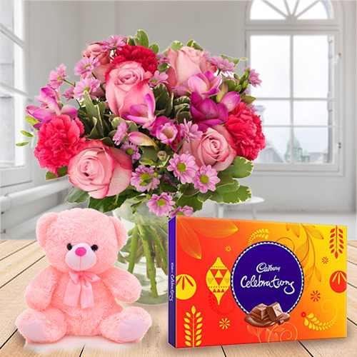 Anniversary Delight Mixed Flowers in a Vase with Gratifying Cadbury Celebration N Small Teddy