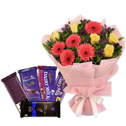 Breathtaking Combo of Mixed Flowers Bouquet with Assorted Cadbury Chocolates