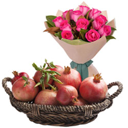 Carefully-Selected Basket of Pomegranates with Pink Roses Bouquet