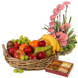 Luxurious Gift of Fresh Fruits Basket with Pink Carnations Basket and Mixed Dry Fruits