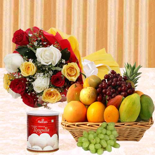 Pleasant Selection of Fruits Basket with Haldiram Rasgulla and Fragrant Roses Bouquet