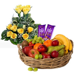 Outstanding Combo Pack of Roses with Fruits Basket and Dairy Milk Silk