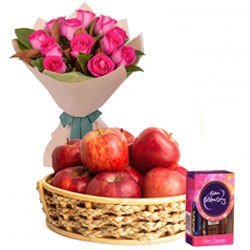 Sweet Selection of Cadbury Celebration with Fresh Apples Basket and Bouquet of Roses