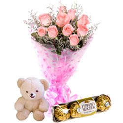 Beautiful Midnight Present of Sweet Chocolates with Aromatic Pink Roses and Small Teddy
