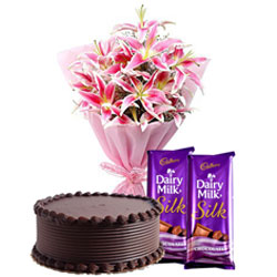 Supreme Midnight Gift of Delightful Chocolate Cake with Dairy Milk Silk and Lilies Bouquet