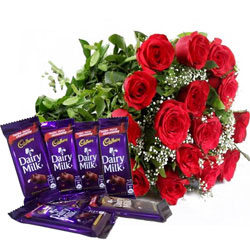 Mesmerizing Bunch of Red Color Roses with Chocolates