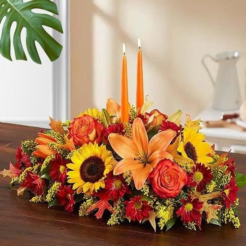 Stunning arrangement of colorful Flowers with 2 Candles