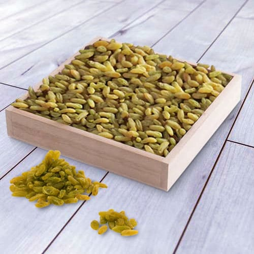Delicious Raisins in a Wooden Tray