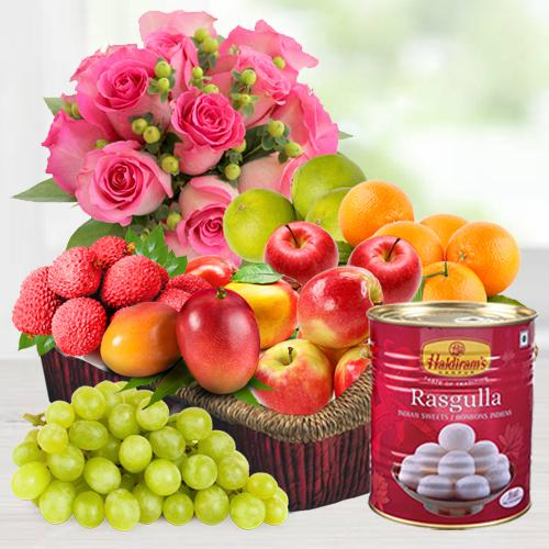 Bouquet of Pink Roses with Rasgulla N Fruits Basket