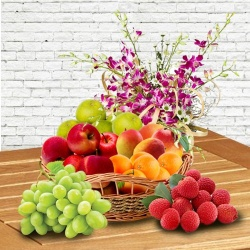 Fresh Fruits Basket decorated with Orchids for Mothers Day