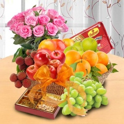 Fresh Fruits n Sweets in a Basket with Pink Rose Bouquet