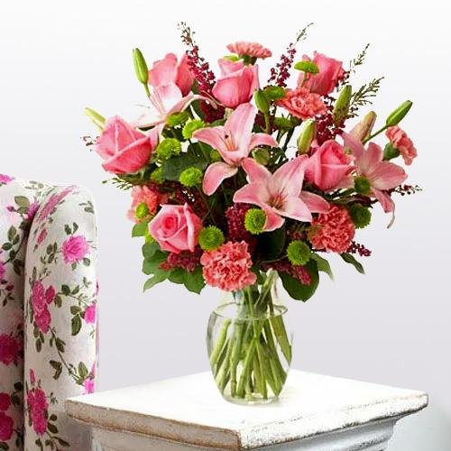 Attractive Arrangement of Lilies, Roses and Carnations