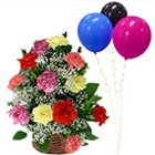 Amazing Display of Mixed Carnations in a Basket with Balloons