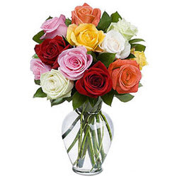 Display of Colorful Roses in a Glass Vase