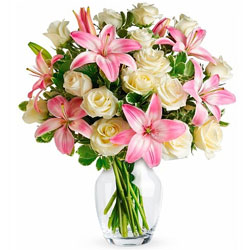 Arrangement of Lilies with Roses in Glass Vase