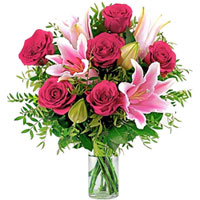 Stylish Arrangement of Pink Lilies N Red Roses in Glass Vase