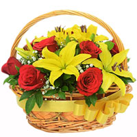 Premium Basket Arrangement of Red Roses with Yellow Lilies