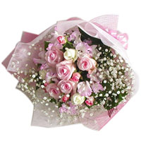 Exquisite Floral Arrangement of Baby Pink N White Roses adorned with White Foliage
