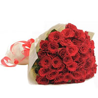 Warm Sunset Bouquet of Red Roses beautifully wrapped in Tissue