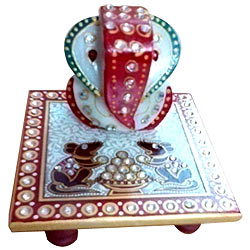 Delicately carved marbel designer ganesh with chowki