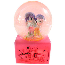 Heart Melting Love Couple in LED Lighted Glass Globe with Floating Tinsel
