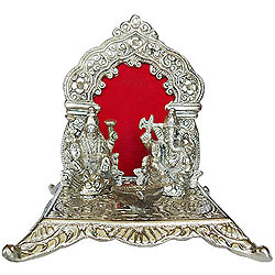 Glittering Silver colored Holy Laxmi Ganesh in a Exquisite Mandap and Diya