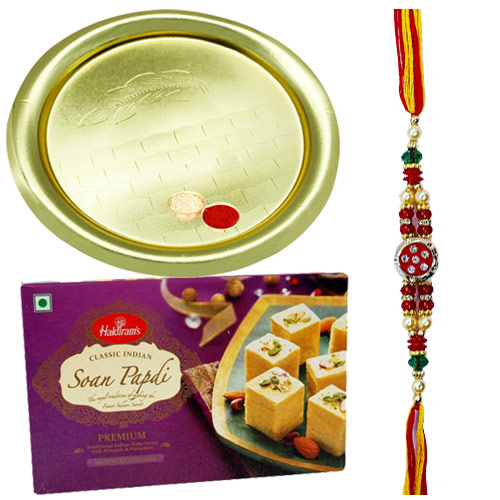 Ecstatic Gift of Tasteful Soan Papri Pack of 100 Gms from Haldirams accompanied with Gold Plated Thali