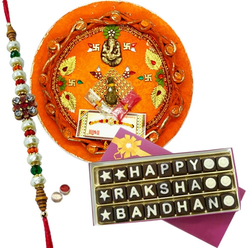Ravishing Gift of Designful Thali accompanied with Luscious Chocolates of Rakshabandhan