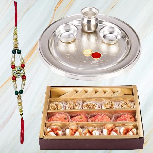 Premium Assorted Sweets from Haldiram and Stylish and Trendy looking Silver Plated Paan Shaped Puja Aarti Thali (weight 52 gms) along Rakhi, Roli Tilak and Chawal